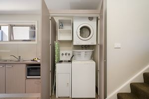 The Laundry of a 2 Bedroom Townhouse Apartment at Birmingham Gardens Townhouses.