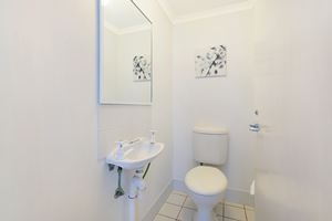 Sandbar Apartment provides a second toilet on the downstairs living space.